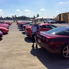 Chamberlain's parked their red  Corvette in special red parking lot at Bloomington Gold 2019.jpg